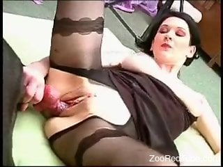Dark-haired hottie and her trained doggy have nice sex