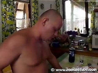 Two awesome models and bald fucker are enjoying sex with a black doberman