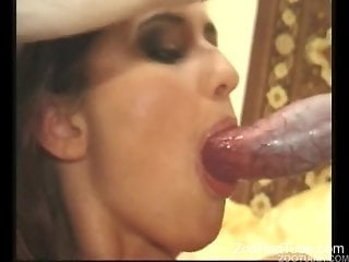 Naked wife plays with the dog's cock in her mouth