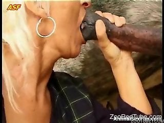 Mature blonde practicing her BJ skills with a horse