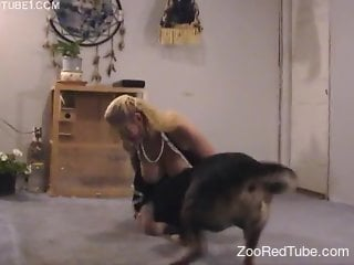 Blond-haired MILF blows her hubby while fucking a dog