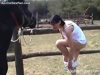 Dark-haired hottie deepthroats a horse cock outdoors